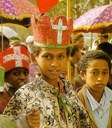 A boy with colorful religious drss