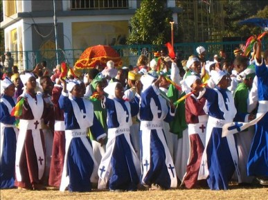 Youngesters with religious dress singing